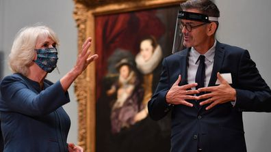 Camilla, Duchess of Cornwall speaks to National Gallery Head of Conservation Larry Keith as they look at the newly restored Equestrian Portrait of Charles I by Flemish artist Anthony Van Dyck during a visit to the recently reopened National Gallery on July 28, 2020 in London, England.