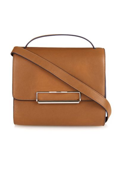 <p>This tan leather version of the boxy shoulder bag the brand have introduced (other versions include navy leather and a berry python) is a fast favourite.</p>