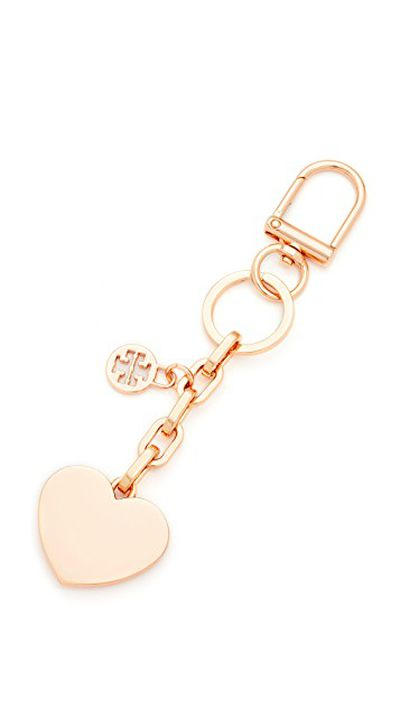 "<em><a href=""https://www.shopbop.com/logo-heart-metal-key-fob/vp/v=1/1574832324.htm?folderID=13567&amp;fm=other-viewall&amp;os=false&amp;colorId=11784"" target=""_blank"">Tory Burch Logo &amp; Heart Metal Key Fob, $76.45&nbsp;</a></em>"