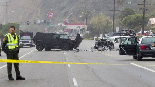 A 69-year-old woman was killed when her car was hit by an oncoming Humvee. (AAP)
