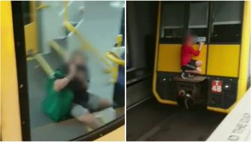 A Sydney commuter managed to film a teen risking his life on the back of a train.
