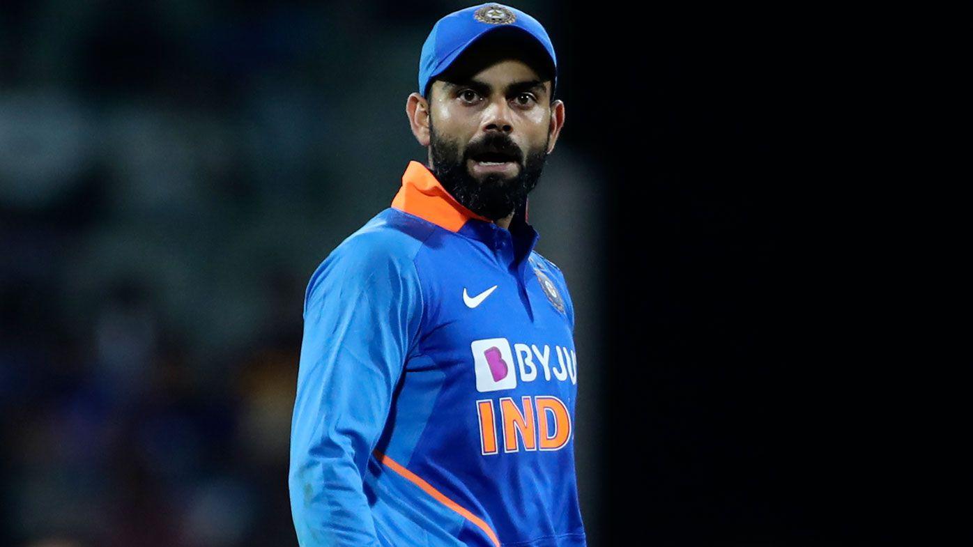 India's captain Virat Kohli reacts