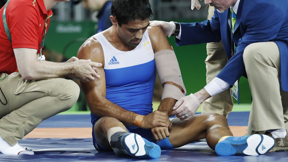 Talgat Ilyasov receives medical treatment. (AFP)