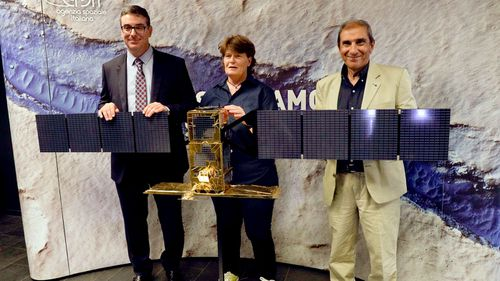 Italian astrophysicists Roberto Orosei, Elena Pettinelli and Enrico Flamini at the Italian Space Agency headquarters prior to a press conference in Rome. (AAP)