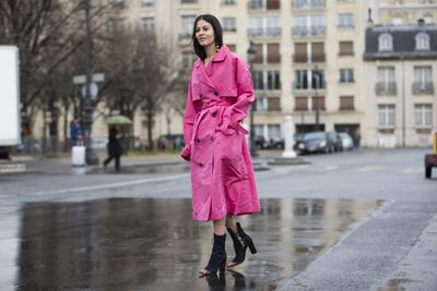 Gilda Ambrosio lights up Paris in her Alessandra Rich trench.