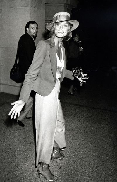 Lauren Hutton has long been a fashion icon for strong, unique women. Here, her mismatching suit and tilted fedora combine boyish charm with feminine elegance.