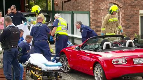 An 86-year-old man was crushed by his own car in a friend's driveway.