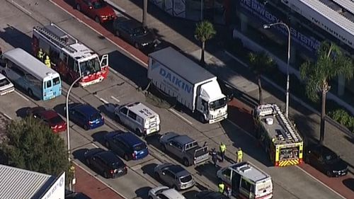 Man charged after woman hit by two trucks in Sydney's Northern Beaches