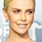 The 'Hollywood' way Charlize Theron covered her regrowth on the red carpet