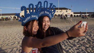 Yui Fujioka and Seika Kanki of Japan take a selfie on the first day of the new year.
