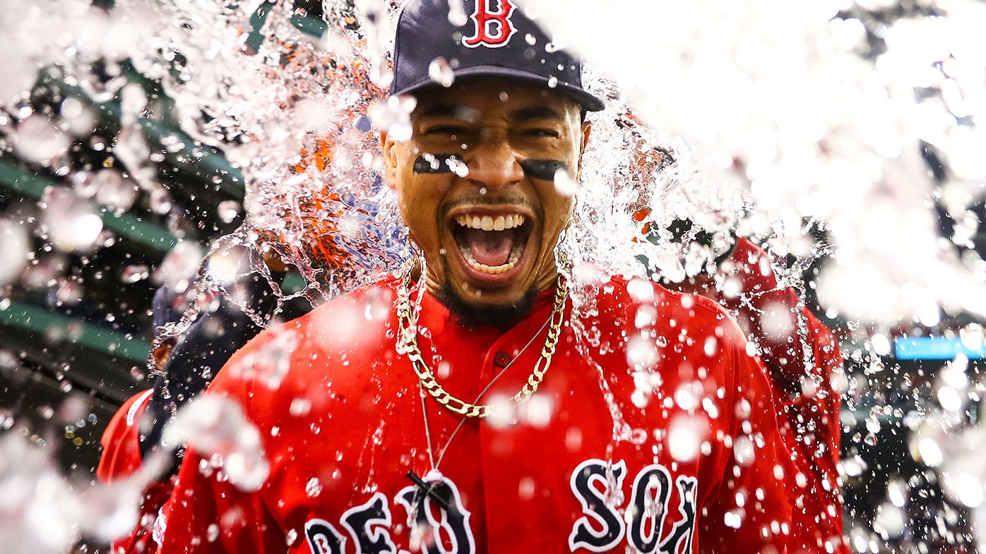 Mookie Betts showered in Gatorade after the Boston Red Sox defeated the New York Yankees 10-5 at Fenway Park on July 26, 2019