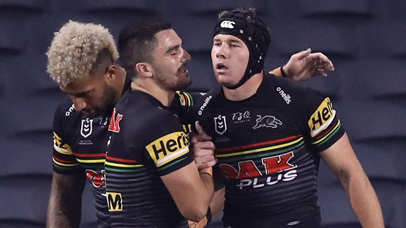 Matt Burton of the Panthers celebrates with team mates after scoring his second try during the round four NRL match between the Penrith Panthers and the New Zealand Warriors