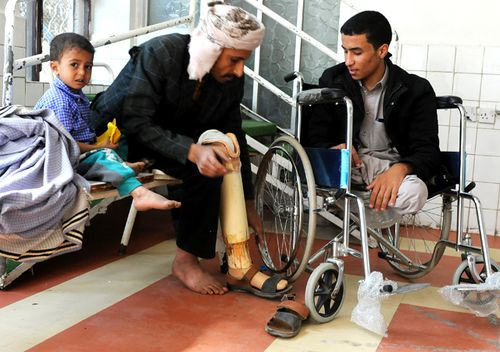Men in Sana'a with amputated legs wait for their a prosthetic limbs, on the third anniversary of the Yemen civil war. (Getty)