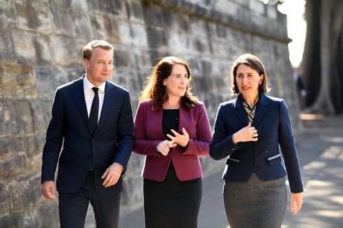 Premier Berejiklian, NSW Minister for Roads Melinda Pavey and Member for Manly James Griffin leave after speaking to the media in Sydney, today. Picture: AAP
