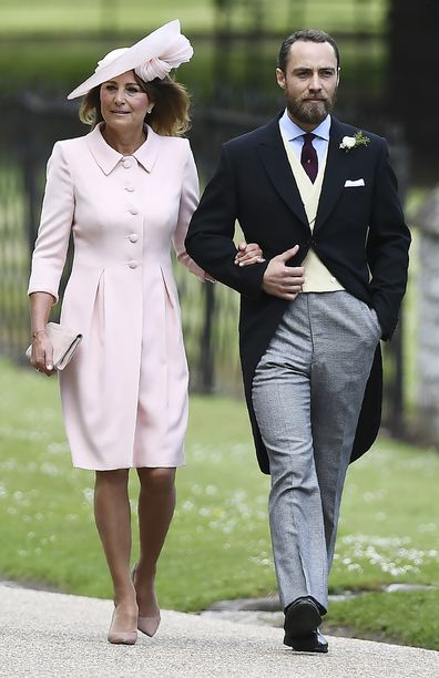 James Middleton (R), brother of the bride, walks with his mother Carole Middleton as they attend the wedding of Pippa Middleton and James Matthews at St Mark's Church in Englefield, west of London, on May 20, 2017. Pippa Middleton hit the headlines with a figure-hugging outfit at her sister Kate's wedding to Prince William but now the world-famous bridesmaid is becoming a bride herself. Once again, all eyes will be on her dress as the 33-year-old marries financier James Matthews on Saturday at a