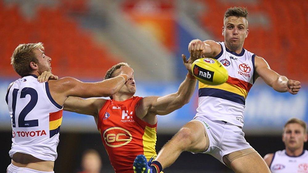 Brodie Smith of the Crows punches the ball. (Getty)