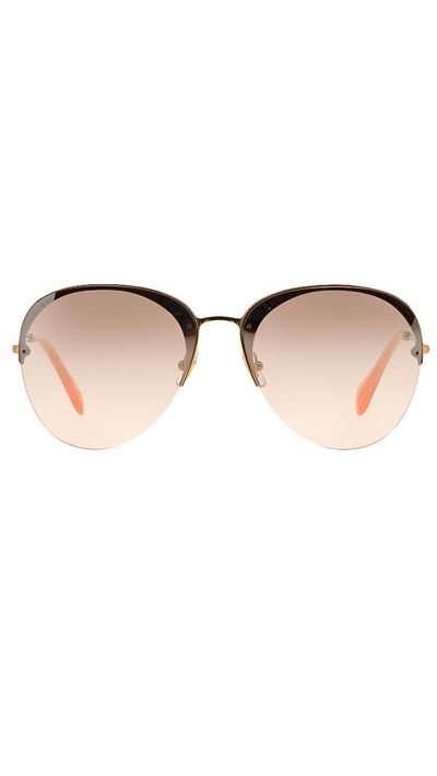 "<a href=""http://www.sunglasshut.com/au/8053672211603"" target=""_blank"">Sunglasses, $440, Miu Miu at sunglasshut.com</a>"