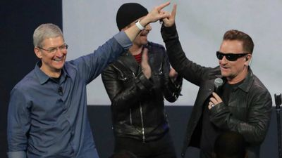 Apple CEO Tim Cook and U2 frontman Bono shared this unusual high-five at the recent iPhone 6 launch. (Twitter)