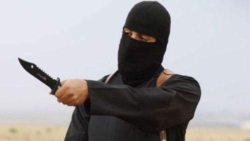 Jihadi John uses a knife threateningly in an ISIL video. (Supplied)