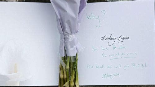 Flowers and condolence messages were placed at a statue of Joseph Priestley near the scene in Birstall.(AAP)