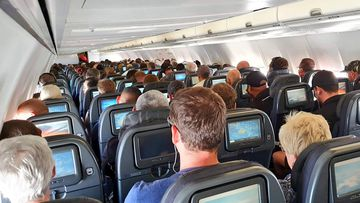 This photo purportedly showed a busy plane flying to Brisbane on April 13. Qantas has said middle seat booking is no longer available.