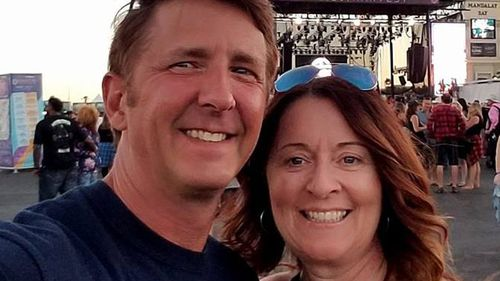 Denise Salmon Burditus, 50, uploaded this photo with her husband to Facebook just before the attack. (Image: Facebook)
