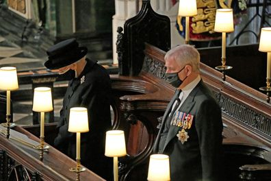 WINDSOR, ENGLAND - APRIL 17: Queen Elizabeth II and Prince Andrew, Duke of York attend the funeral of Prince Philip, Duke of Edinburgh at Windsor Castle on April 17, 2021 in Windsor, England. Prince Philip of Greece and Denmark was born 10 June 1921, in Greece. He served in the British Royal Navy and fought in WWII. He married the then Princess Elizabeth on 20 November 1947 and was created Duke of Edinburgh, Earl of Merioneth, and Baron Greenwich by King VI. He served as Prince Consort to Queen