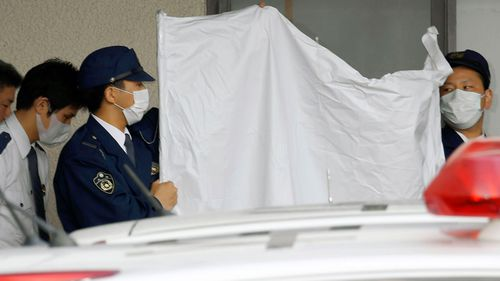 Japanese arrested for reportedly caging son for 20 years