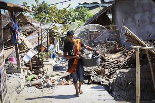 Tourists and local residents have been left in chaotic conditions after a 7.0-magnitude earthquake devastated Indonesia's Lombok and Gili Islands. Picture: AAP.