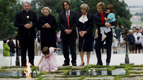 Saoirse Kennedy lays a white rose at President John F. Kennedy's gravesite in 2000.