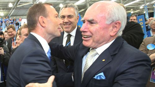 Former PM Tony Abbott (left) and John Howard (right). (AAP)