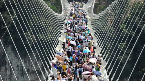 Record-breaking glass bridge in China closed due to 'overwhelming demand'