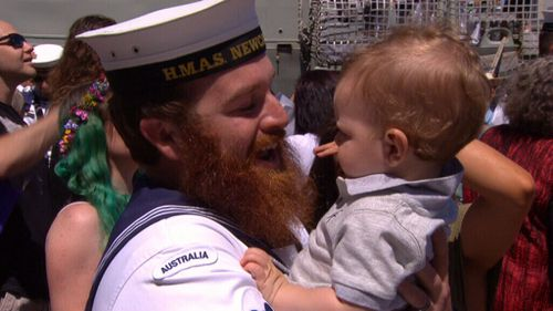 Seeing their young children brought smiles to even the most steely-faced sailors (9NEWS)