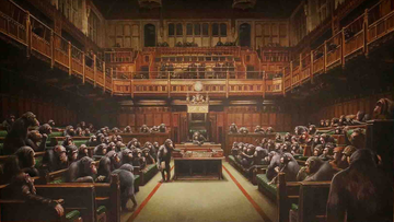 "British artist Banksy's ""Devolved Parliament,"" a satirical oil painting depicting the House of Commons filled with chimpanzees, has sold at auction in London for a record-breaking £9,879,500 ($12,200,000). Full credit: Jonathan Brady/PA Images via Getty Images"