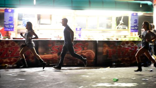 People are shown running from the concert. (Getty Images)