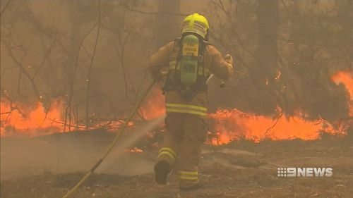Firefighters have been battling rapid winds, at times in excess of 100km/h, and extremely dry land.