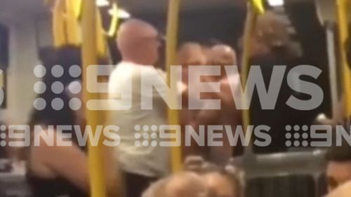 The man and the teens can be seen having a heated discussion. (9NEWS)