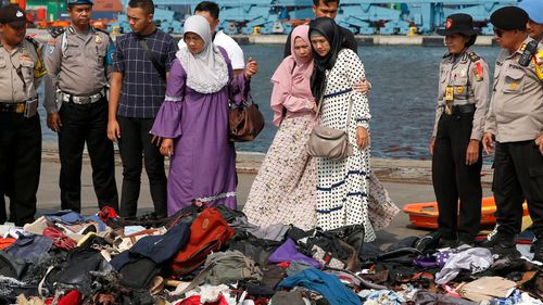 Families of victims sob as they inspect debris found floating after the Lion Air flight.