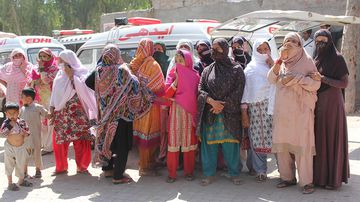 Distraught relatives of the victims wait to receive their bodies. (AAP)
