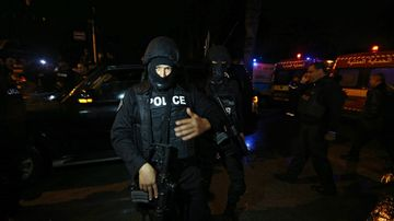 Police at the scene of the Tunis blast. (AAP)