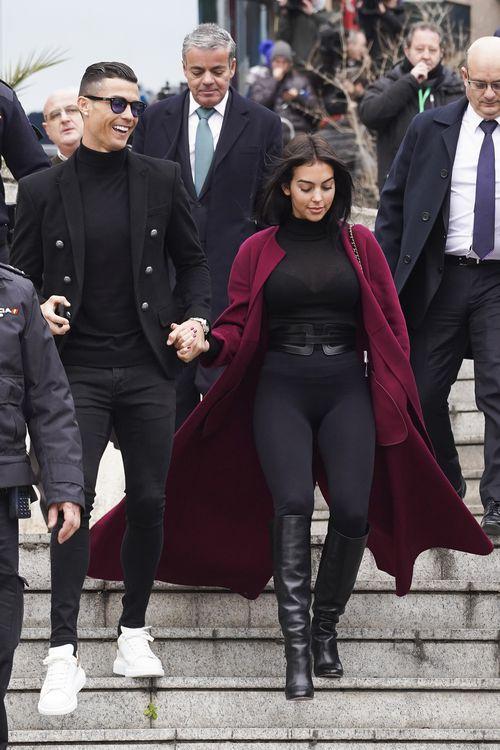 Cristiano Ronaldo and his partner Georgina Rodriguez were met by a media scrum.