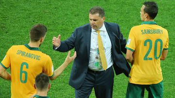 Socceroos coach Ange Postecoglou speaks with players.