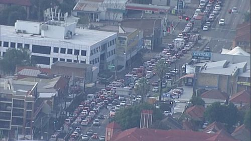 Motorcycle and bus collision cripples traffic in Sydney's inner west