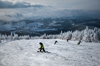 January 17, 2017 - Snowboarders and skiers make the most of good conditions at a ski resort inRokytnice nad Jizerou, Czech Republic. (AAP)