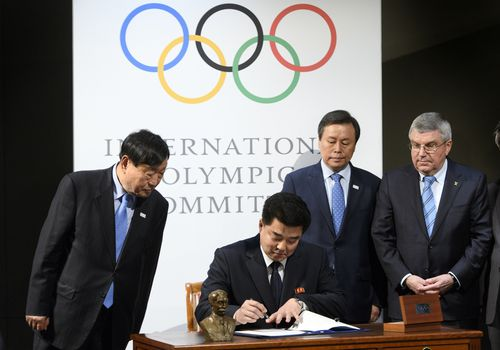 A signing ceremony during the North and South Korean Olympic Participation Meeting at the Olympic Museum of the IOC yesterday. (AAP)