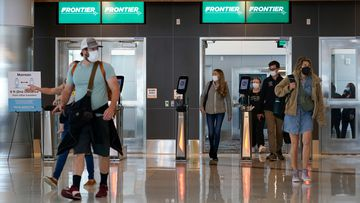 Passengers arrive at the West Gates at Tom Bradley International Terminal at Los Angeles International Airport.