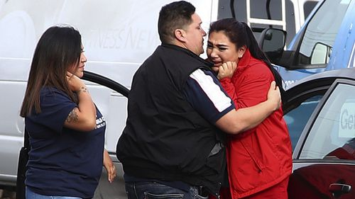 Caregivers at the home were seen distraught throughout the California siege (AAP).