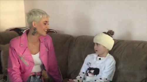 Katy Perry has surprised eight-year-old superfan Grace Moores at her home after brain surgery meant she was unable to go to the singer's concert. Picture: Supplied