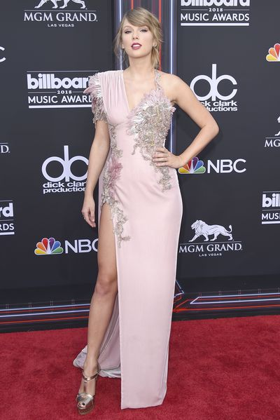<p>The 2018 Billboard Music Awards awards have kicked off in style at the MGM Arena in Las Vegas.</p> <p>Music's biggest stars didn't disappoint as they pulled out all the stops as they walked the red carpet for music's big night.</p> <p>Taylor Swift lead the charge in a blush hued Versace gownwith a thigh-high split for her first red carpet appearance in two years. </p> <p>While Jennifer Lopez channeled old-school J.Lo as she turned heads in head to toe deep red faux alligator Roberto Cavalli with a burgundy bra on show. The singer completed the look in sky-high Casadei leather boots.</p> <p>Take a look at the most talked about looks of the night…</p>