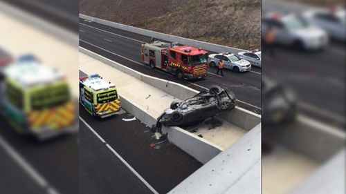 Driver critical after car plunges over Adelaide bridge onto freeway below